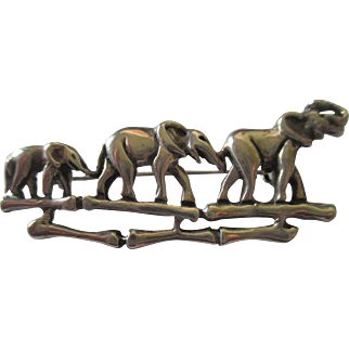 Collectible sterling silver three elephant brooch