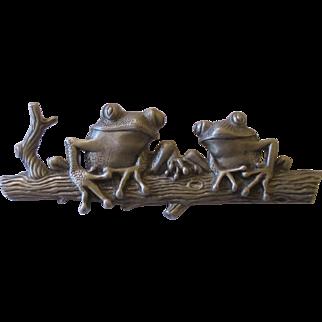 J.J. Jonette pewter Frogs on tree trunk brooch