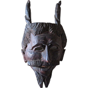 Vintage hand carved wooden Devil Tribal mask