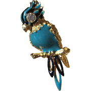 Cute gold tone bird with enamel body, numbered in back