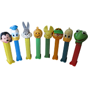 Eight Vintage Pez 1976 Tablet dispensing receptacles