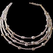 Dainty faux Pearl, glass rhinestone 4 strand Nolan Miller necklace