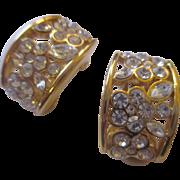 Nolan Miller gold tone/ shiny rhinestone earrings