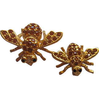 Pair of golden rhinestones Joan Rivers brooch