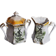 R.S. Germany (19th Century) Porcelain and Hand Painted tall Sugar with Lid and matching Creamer