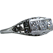 Vintage Three Stone Filigree Platinum Diamond Engagement Ring - 0.87ct.