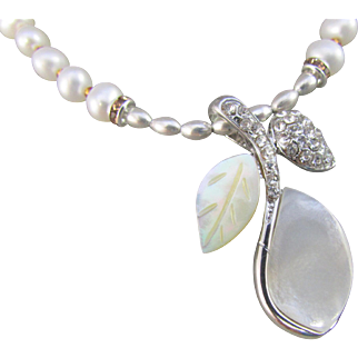 A Handmade Mother of Pearl and Shell Leaf Pendant and Cultured Freshwater Pearl Necklace