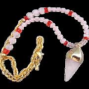 A Pink Quartz Pendulum Chakra and Bead Necklace