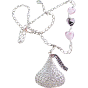 "A Sparkly ""KISS"" Pendant and Trio of Glass Hearts Necklace"