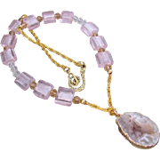 A Geode Slice Agate Pendant and Pink Glass Necklace and Earrings