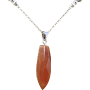 Faceted Carnelian Bullet Pendant and Carnelian Necklace and Earrings