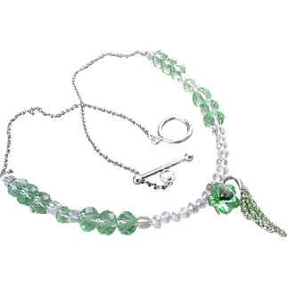 A Green Austrian Crystal Wing Pendant and Rondelle Necklace and Earrings