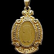 Beautiful 18 Karat Yellow Gold pendant in a 22 Karat Gold Bezel Lady Fortuna Bar