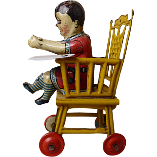 Penny toy high chair with child from Meier, Germany, 1900