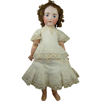 """Extremely Rare French Mystery Bébé with a very expressive face, marked """"6""""."""