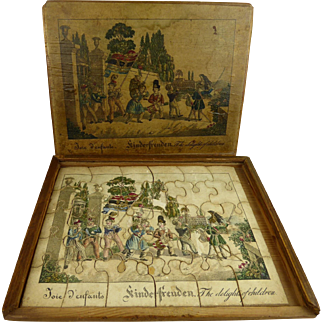 Antique wooden hand-coloured dissected Puzzle  in 3 languages, dating from appr. 1850.