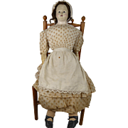 All original large  early paper maché Pauline Biedermeier Doll from 1860 dressed in her original clothes.