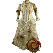 Antique original French fashion flowered two-piece dolls dress with matching fashion straw hat, appr. 1870