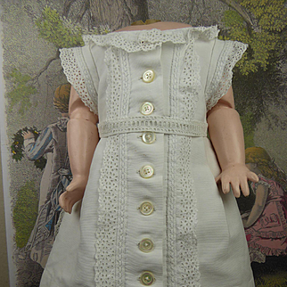 Antique original French white pique dress with exceptional back panels for a Bébé or an early doll appr. 1870