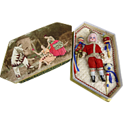 Antique French original tiny Pierrot and his musical instruments in a beautiful antique presentation box with a theatrical scene.