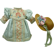 French blue sateen and lace dress for a tiny antique Bébé with matching sweet original antique straw hat
