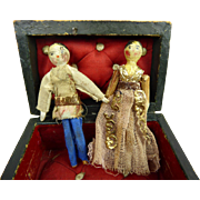 Small Male and Femal Grodnertal peg dolls in their early wooden box