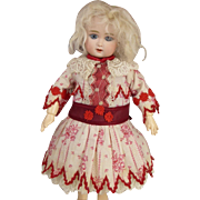 Wonderful  tiny  French muslin patterned antique doll dress, typical French pattern , with a matching hat.