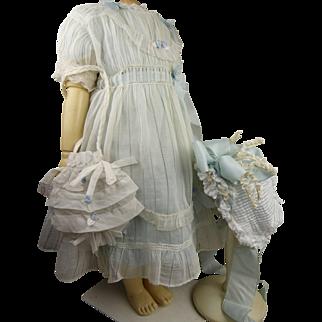 Four-piece  ensemble : original antique marked white striped batiste dress, a blue under dress, a batiste tucked bonnet, and a pleated purse
