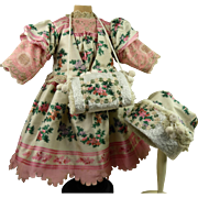 Marvelous embroidered silk French antique doll Christmas dress with matching bonnet and muff.