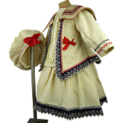 Marvelous creamy muslin French antique doll sailor/mariner dress with matching beret and whistle.