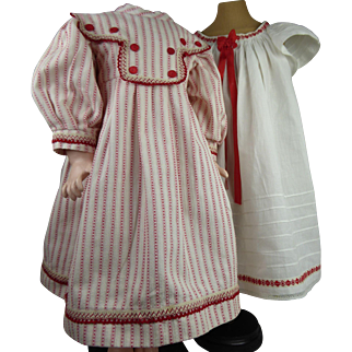 Original antique white batiste open-back pinafore with a striped cotton dress for an antique French or German doll