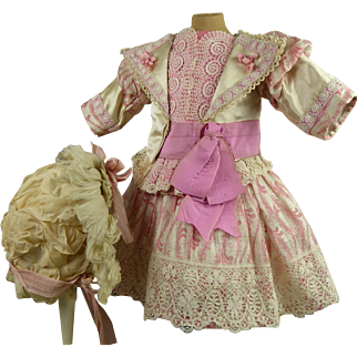 Exquisite pink patterned and ivory silk French antique doll one-piece couturier dress with beautiful antique  bonnet