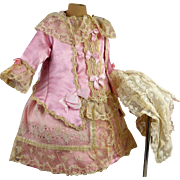 Exceptional pink silk couturier antique doll dress with beautiful lace and gauze overlay with matching original antique lace bonnet
