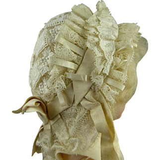 Very elaborate all original French lace Jumeau bonnet with box pleated brim and loops from appr. 1880
