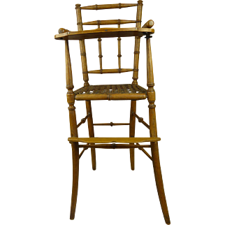 Wonderful original antique French faux-bamboo dolls armed high chair.