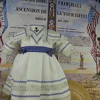 Wonderful French white pique mariner/sailor antique dolls dress with a matching straw hat