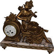 Antique Figural Marble Clock Made By Charmeuse D' Oiseaux. The case is made of bronze and marble. The clock is in perfect working condition