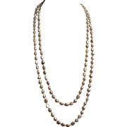 59 inch continuous freshwater, peach colored, Pearl Necklace
