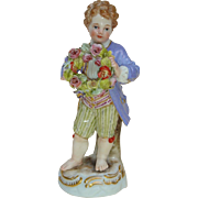 Late 19th c. Meissen Boy Holding a Floral Wreath