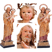 18th Century Sculpture of St. Joseph with Jesus Child - Wood Carved Polychrome Baroque Figure with Gilt and Glass Eyes