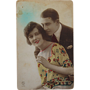 1920's Postcard from Paris France of a couple in love - colored real photo