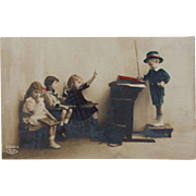 1920's Postcard of of little children playing school - colored real photo