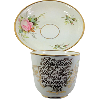 Beautiful Porcelain Presentation Cup and Saucer. Dated 1886 Pink Roses.