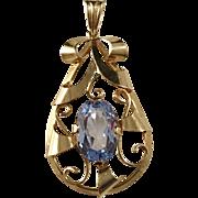 Juvelfabriken, Sweden year 1945 Mid Century 18k Gold Light Blue Stone Pendant.