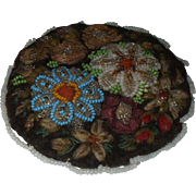 A mid Victorian Beaded Pin Cushion with Fabric and Beaded flowers