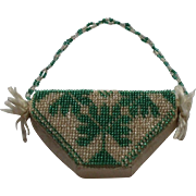A Charming Early 19th Century Bead Work and Cherub  Basket Pin Cushion