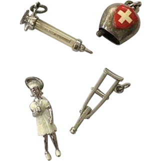 Four Medical Vintage Sterling Silver Charms: Nurse, Red Cross Cow Bell, Syringe, & Crutch