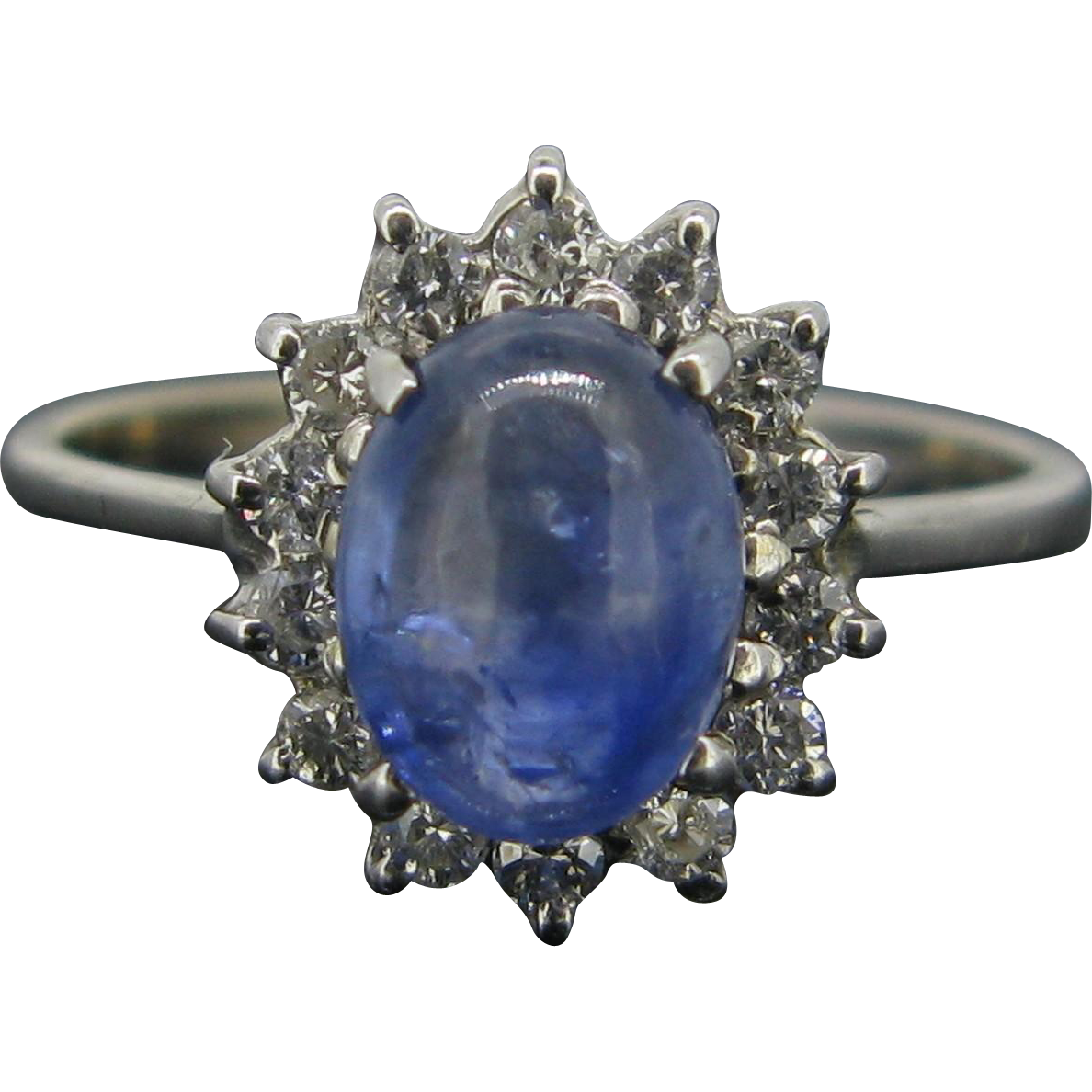 An eternal blue sapphire and diamonds daisy cluster ring