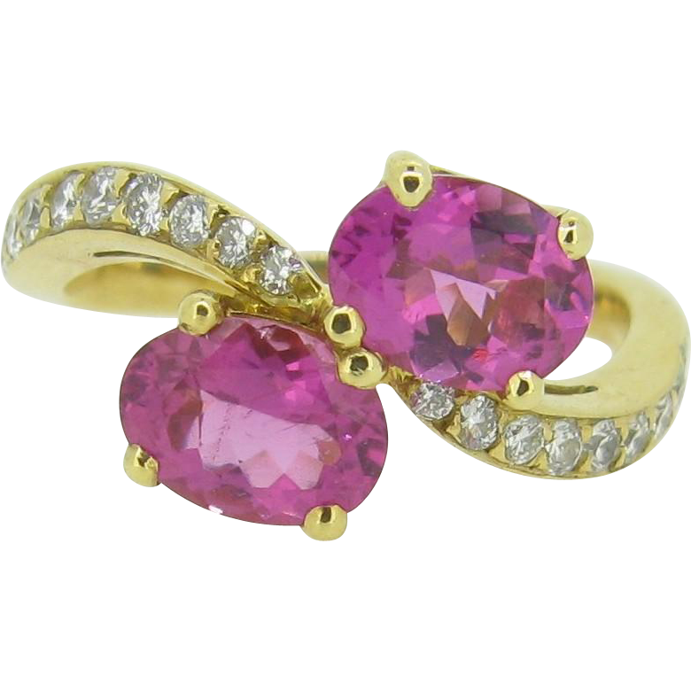 A lovely French pink tourmalines crossover diamonds ring on 18kt yellow gold