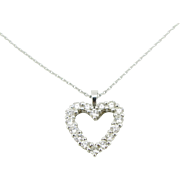 A French modern and chic diamonds heart pendant, 18kt white gold